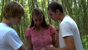 Two dudes begin banging a horny golden-haired's bawdy cleft cleft outdoors